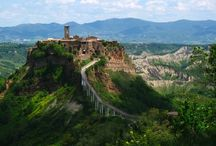ITALY - BECKY AND BARRY'S AWESOME ITALY TRIP - CIVITA DI BAGNOREGIO / Civita di Bagnoregio  is noted for its striking position atop a plateau. It seems like it is in constant danger of falling off it's perch, down into the Tiber valley below. We were blown away by it's magnificent elegance. Enjoy our stroll around town!- via Magnlila Hall at www.magnoliahall.com