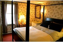 "Room Six - The Old Village Inn / Room six is located on the third level of our establishment and is considered a ""two-room"" suite.   Bedroom w/Queen Bed Living Room Day Bed in Living Room Large Balcony with Ocean View"