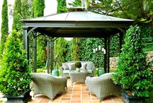 Outdoor spaces / Take your porch or patio to the next level. Here are some ideas to create an outdoor living room complete with a sofa, fountain, greenery galore & even a chandelier. www.livinginteriors.net