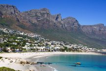 South Africa / Cape Town's most distinctive feature is its stunning setting: it lies on a dramatic coastline of pristine white beaches  and icy waters, overlooked by the iconic flat-topped Table Mountain. It is arguably South Africa's most picturesque city  and while the world knows about the regions winelands, it has also become internationally recognised for the food  culture as well!