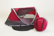 PeaPod / The KidCo PeaPod is a line of children's travel beds perfect for short trips or long visits.  The PeaPod automatically pops open and sets up for use instantly.  After use, it simply folds up and is storied in its own carry bag, once again ready for use.  Lightweight mesh is great for air flow and as an insect screen.  Micro-Lite sleeping pad comes pre-assembled.  Extra large zipper panel for easy access.  50% UV protection.  The PeaPod travel bed is for use with children 1 to 3 years of age.