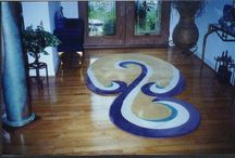 Swirls and Shaped Rugs / A custom rug can be shaped to spillover or accent an entryway--for those places that are hard to find in standard sizes