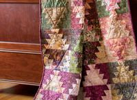 Layer Cake Quilts / by Michele
