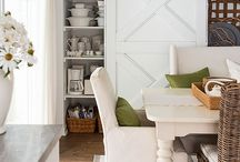 Sliding door for downstairs laundry and shelving, hide chute and laundry basket