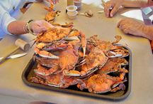 Crab Pickers Paradise / Catch the savory aroma of Old Bay in the air, hear the rhythmic sound of wooden mallets cracking shells, and experience the sweet taste of steamed Maryland blue crabs.
