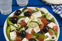Food in Greece and Crete / Enjoy Greek food while you are in Greece - Crete or anywhere in the World . Popular dishes like Mousaka , Stuffed Tomatoes , Tzatziki , Soutsoukakia , Boureki , Stifado , Taramosalata , Greek Salad , Kleftiko , Gemista , Souvlaki etc. etc .