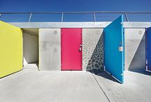2017 Highly Commended - Milford-on-Sea Beach Huts / The 119 beach huts in Milford-on-Sea in the New Forest were constructed to withstand a 1:200-year storm event. Concrete was the chosen material for the project, due to the exposed location of the site. Its structural capacity allowed significant enhancements to the project's functionality, including the creation of a roof-top promenade. The design uses graphic printed concrete & relief artwork. Snug Architects, Ramboll and Knights Brown, with New Forest District Council worked on the project.