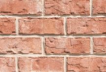 Key West  Triangle Brick Company / If you're looking for an exterior cladding option inspired by the vivid architecture of the Florida tropics, our Key West tumbled brick is the perfect choice. This soft salmon-colored brick provides a uniquely tropical feel to your building project, featuring subtle pink undertones and gray highlights for a look that's just as bright and sunny as it is peaceful and serene. The Key West brick is part of Triangle Brick Company's exclusive Premium product tier.