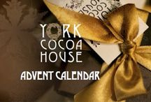 Chocolate Advent Calendar /  You're never too old to enjoy a Chocolate Advent Calendar! Join us we prepare for Christmas by opening the door each day on our Cocoa House Advent Calendar and discover chocolate indulgences for you to enjoy with us daily at the Cocoa House, to order on-line, to reserve in our Chocolate Cafe, in our Chocolate Workshop or to make at home. With a different chocolate treat to discover all day, we hope you have a very special Christmas!