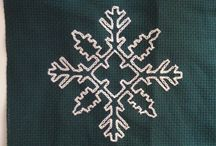 Snowflakes / A collection of snowflake cushions inspired b y Sardinian knot embroidery
