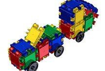 Toy Construction Truck / At Fat Brain Toys we know - it's the scoops, the levers, the rugged all-terrain wheels, the endless potential for loading and dumping and pushing. These are the things that make a good construction toy or truck - great!