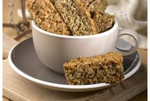 """Recipes to Share - Rusks / Beskuit / Rusks (in Afrikaans beskuit) was borrowed from French - """"Biscuit de guerre"""" (hard bread for war time). Biscuit means """"twice baked"""". Rusk were sold to the sailors & passengers of passing ships in Cape Town since the 1600's & to expeditions that ventured into the country's interior. Many families still prefer to bake their own rusks. Nowadays it can contain bran, oats, raisins, sunflower seeds and much more. This makes it just as much a healthy breakfast snack as an ideal coffee break treat."""