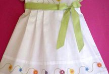 white frock with green belt