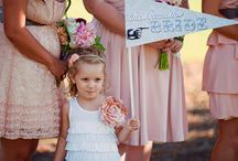 Flower Girl Fashion / Most little girls are beyond excited when they learn that they have been selected as the flower girl in a wedding. Flowers girls are no longer limited to wearing a miniature replica of your dress. Tutus have become popular, as well as off-white tea-length dresses. There are also many other looks which you can find on Etsy, in a bridal salon, or even in department stores. / by My Wedding Reception Ideas