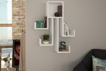 Modern Wall Shelves / Enliven a dull space by getting home the Decortie Design Wall Mount Shelf.  If simplicity is what you appreciate, then these shelves are surely going to catch your eye. Crafted with attention to detail, these shelves have an underlying charm that surface well against a plain wall.   Contemporarily - designed, this shelf has a great color finish, which blends well with other furniture in the room.