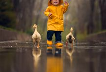 Child walking with ducks