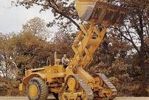 Stavební stroje a nákladní auta a traktory