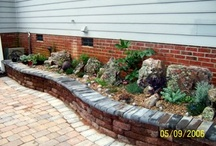 Backyard re-design / Add beds and interest to boring back yard. Simulate courtyard with curving lines, pavers, bench seating and fountain. / by Kathryn Lansden