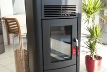 Black Wood Pellet Stoves and interior design inspiration / Pictures of black wood pellet stoves.  Pictures of wood pellet stoves that compliment black as an interior design colour.