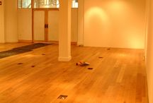 Junckers Solid Wide Board Oak Oiled Finish To Gallery / Client: Crafts Council London. Brief: To replace an existing wooden floor which was underperforming, with a premium oiled Junckers Oak floor recommended by us . All work to be carried out in a tight timeframe, to allow exhibitions to continue and allow for floor to accommodate 18 existing floor sockets. The solution: The existing wooden floor was uplifted and removed, the subfloor improved and levelled as best possible.