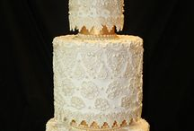 gold/silver wedding cakes / by Robin Koelling