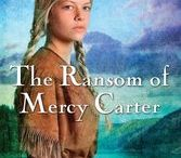 """The Ransom of Mercy Carter / """"…days turn into months and Mercy, who has become a Kahnawake daughter, thinks less and less of ransom, of Deerfield, and even of her """"English"""" family. She slowly discovers that the """"savages"""" have traditions and family life that soon become her own, and Mercy begins to wonder: If ransom comes, will she take it?"""""""