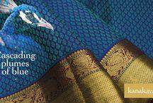 The Peacock Series / Embossed with #peacock block motifs in gold #zari, these Kanakavalli Kanjivaram drapes you in cascading plumes of beautiful shades! #silk #sari