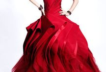 Red Weddings / Red is always in style. By itself, accented by metallics or black and white, it is stunning. Add a second color - teal, hot pink, orange, or purple come to mind - and everything pops. If you're set on a red wedding dress, you'll find them here.