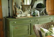Black lamp shades  on olive dresser