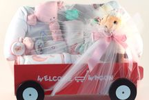 """Baby Girl Gift Wagons / Our baby gift wagons for girls are our """"Most Popular Baby"""" item. Who doesn't love a Red Flyer Wagon? We have a large selection of gift wagons filled with baby girl items to celebrate the birth of the new baby. We have themed gift wagons for that special baby. We have adorable gift wagons for the future ballerina, NY Yankee fan, deluxe flower wagon, lamby love gift wagon, baby Einstein & more!"""