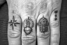 Finger tattos