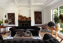 Alfonso / *mostly all white *black architectural elements - ceilings, doors/windows, *fireplaces, select cabinetry *natural elements - rugs, accessories, window shades, lamp shades *bright colors used sparingly and for impact - artwork, pillows,secondary bedrooms