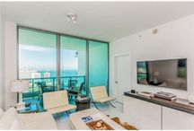 FOR RENT ~ 900 Biscayne Bay #4910 / LIGHT & BRIGHT High-End Finishes! Hi-floor small 2 Bed/2 Bath w spectacular Biscayne Bay Water Views. 10' Ceilings. White Glass floors thruout. Laminated White Glass Rolling Walls separate 2nd bedroom to Common Areas. Open Plan w/Wenge Wood Italian Kitchen, SS Miele appliances & Sub-Zero Ref. Gorgeous Custom White Oak Wood Closets. AVAILABLE JULY 1 | Listed For: $3,000/month