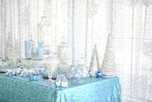 Turquoise Winter Corporate Candy Bar / This delicious candy bar was styled under a canopy of floating snowflakes and framed by a sequin silver winter backdrop with complimenting hanging snowflakes. A delicious addition to this intimate winter Christmas corporate event which also included a perimeter of cascading warm white fairylights and strategically placed crisp white curtained fairylights walls, which came to life in the evening. See the full film on our Youtube channel: https://youtu.be/HFAutUKg8Zg