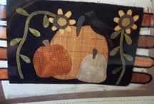 Wool penny rugs & pillows / by Sandra Moore