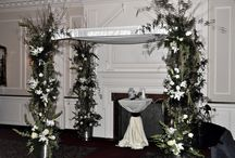 Chuppah Rentals / A Chuppah is a canopy under which a Jewish couple stand during their wedding ceremony. It consists of a cloth or sheet, sometimes a tallit, stretched or supported over four poles, or sometimes manually held up by attendants to the ceremony. A chuppah symbolizes the home that the couple will build together.