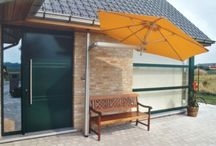 Domestic Paraflex / The unique and patented Paraflex umbrella system provides the solution for so many situations in domestic and commercial applications. It removes the need for a heavy, clumbersome base and a central pole which is nearly always in the way by using a flexible side mounted arm to hold a specially adapted selection of high quality umbrellas. The flexible arm gives a massive wide arc of movement with the added benefit of a tilting function to help combat low early morning and late afternoon sun.