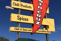 Take a Tour of the Santa Cruz Chili & Spice Company / Located in the heart of the Santa Cruz Valley is the legendary Santa Cruz Chili & Spice Company. The Santa Cruz Chili & Spice Company is both a manufacturer and retailer of fine chili products. A family owned and operated for many years, owners William and Jeanie Neubauer are sure to make your time with them memorable. Stop by today and try their many delicious salsas, pastes & more! To learn more or to gather recipes, please visit www.santacruzchili.com