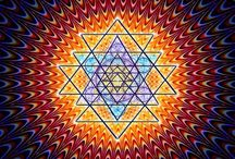 {Mandalas} / Mandala (Sanskrit: मण्डल Maṇḍala, 'circle') is a spiritual and ritual symbol in Hinduism and Buddhism, representing the Universe. The basic form of most mandalas is a square with four gates containing a circle with a center point.