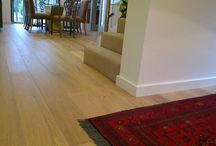 """Wood Flooring Installation / The size of the installation was 30m2 (approx. 300 sq ft) at a domestic property in the UK. The floor was a 16mm (5/8"""") engineered wood (T&G) installed on IL50hg. The home owner is particularly happy with the end result and chose InstaLay because it provided stability for the wood, raised the floor to match the level of the adjoining rooms and was made from rubber crumb, therefore was sufficiently weighty which gave a solid feel to the floor."""