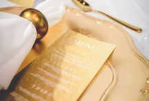 White +Gold Wedding Expo / Crisp, white Pintuck linen set the scene for the stunning gold detailing and luscious white florals put together by our talented floral team. Our stylist worked closely with our graphics and floral departments with the use of complimenting gold nouveau charger plates and our luxe gold cutlery, which framed our teams custom designed menus, placecards and table numbers perfectly. Youtube: https://www.youtube.com/watch?v=gQJ-tXFc1CM&feature=youtu.be