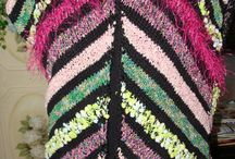 Lucci Jazzy Vest kit / Knit on the diagonal with an assorment of Lucci yarns stylistically placed creates a garment that is flattering to all body types.  Pattern available in kit with yarns from yarn shops.  Contact Lucciyarn.com for a store near you.