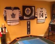 Toronto Maple Leafs / Maple Leaf jerseys displayed using the Ultra Mount Jersey Display Hanger.