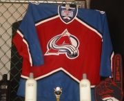 Colorado Avalanche / Colorado Avalanche jerseys displayed using the affordable Ultra Mount jersey display hanger. A great affordable alternative to jersey frames.