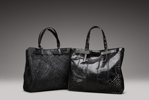 UNIQUE AND IMPECCABLE / Innovative technique and extraordinary craftsmanship mark Bottega Veneta's newest handbags for Spring. Artfully constructed in either hand woven intrecciato nappa Rete Maille, or Ayers emphasized by delicately cushioned intrecciato corners in coordinating Ayers, each distinctive style is aesthetically multidimensional, uniquely nuanced and equally functional.