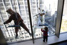 Tokyo window cleaners dress up as horse and sheep ahead of Japanese New Year / Window cleaners, dressed in horse and sheep costumes featuring animal signs from the Chinese zodiac calendar, work during an event promoting the year-end and new year at a hotel in the business district of Tokyo on Dec 19, 2014.  The year of 2014 is the year of the horse and 2015 is the year of the sheep according to the Chinese zodiac calendar.
