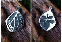 Sea glass reversible pendant with a butterfly wing and leaf theme