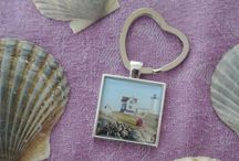 Travel Love Co. Accessories and More / Key Chains, Wine Glass Charms, Ornaments, Purse Holders, Note Cards and more. Each of our products features a beautiful image of a favorite travel destination to help you remember your last trip!