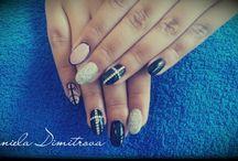 nail / by Daniela Dimitrova
