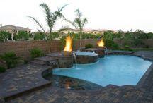 """Fire with Pools and Spas- the WetFlame (tm) / Fire can add a stunning visual element to any pool and spa.   One of Paragon Pools' most innovative designs, the WetFlame (tm), is a combination water and fire feature  developed by Joe Vassallo, CBP.  """"Fire features with pools and spas have become a priority on the homeowner's wish list,"""" states Vassallo. """"Our design team conceives unique and modern ways to present the common campfire.""""  / by Paragon Pools"""